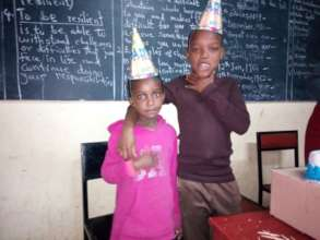 Birthday kids (note the quote on the blackboard)