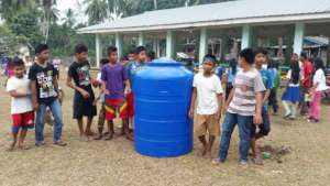 Children excited with 100 gallon rain water tank