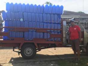 10 gallon water tanks arrive for refugee families