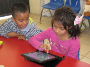 Maricruz learns to use a tablet