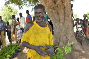 Refugee participant receiving seedlings