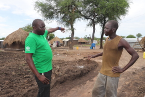 Our coordinator talking with a beneficiary