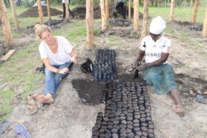 Prepping pots for seedlings in the new nursery