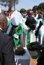 Bishop Bertin laying the school's foundation stone