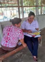 Obstetra Wilda reviewing cancer screening services