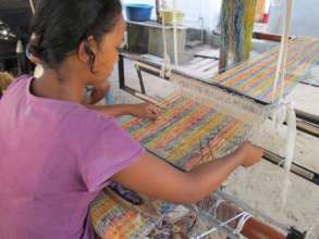 Artisan weaving on new SEPALI loom