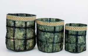 Team designed cocoon silk baskets with raffia trim