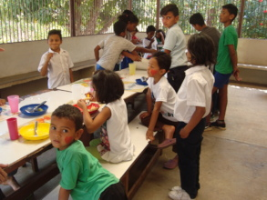 SAI supported orphan children enjoy lunchtime!