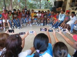 Orphans gather to show-off their brand new shoes!
