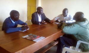 KIFA staff discussing feedback from Angic P/S