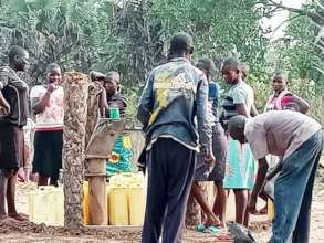 Girls & Community at the Borehole after repair