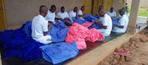 Girls sorting out uniform to be sold: market