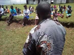 Lead facilitator addresses teenagers on Mt Elgon.