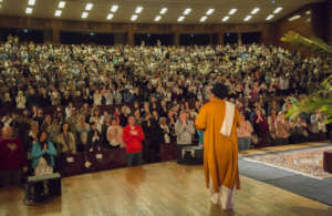 Moojibaba walks on stage at the Lisbon Intensive