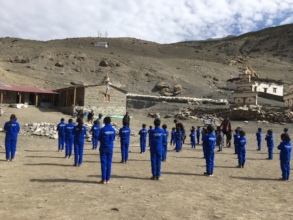 Students in new uniforms and new classrooms