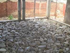 Stones for the concreting of flooring.