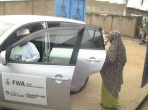 Benita being driven to Gitega Regional Hospital.