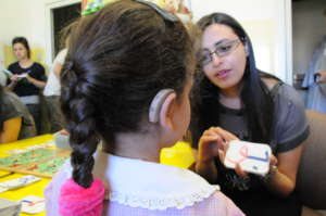 A deaf child with her teacher learning Arabic