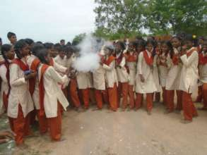 Girl students getting trained in fire extinguisher