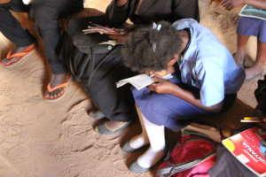 Girl writing during class