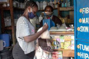Joyce selling soap at a nearby shop