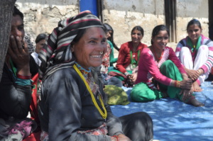 A woman smiles during a Women's Circle in Sipkhana