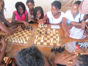 Girls' Club members playing chess.