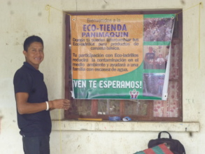 Hanging the sign in front of the Eco-Store