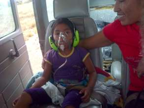 A young girl receiving oxygen.