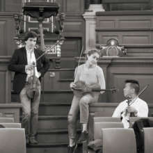 Colleagues taking a moment mid-rehearsal