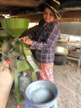 Sarer prepares rice for chicken feed