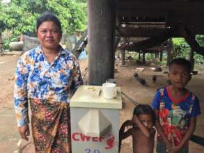Solang with her BioSand Water Filter