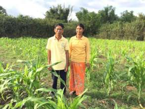Um Ron and his wife on their farm