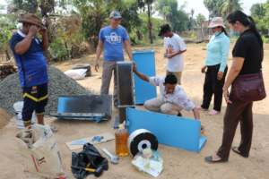 Koy Thea constructing BioSand Water Filters