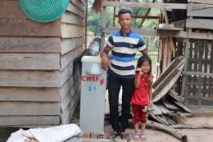 Father and daughter with their BioSand filter