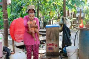 Mother and baby with their BioSand Water Filter