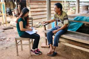 CWEF volunteer visits with local recipient