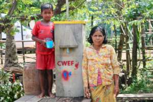 Mother with son drinking clean water from filter