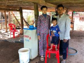 Sambo and Ku, with their young son