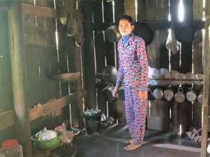 Ku, inside their home