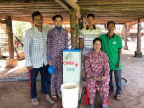 Sambo and Ku, with local pastor and volunteers