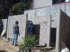 Working on Ms. Elodias house with local volunteer