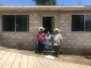 Ms. Gloria, her family, and her new house