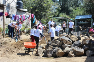 Volunteers digging the foundation for a new home