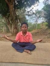 Juan, 8, doing his Yoga class