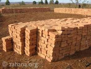 The community already made the bricks