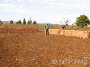 Community made bricks for the future school (2009)