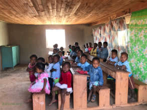 Younger students in one half of the classroom