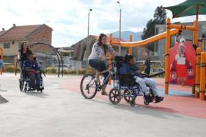 Children play at an inclusive park