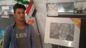 A. with his drawing of Nelson Mandela